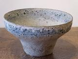 Stoneware bowl with pale<br/> blue & cream pitted rim by Paul Philp